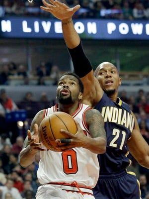 Chicago Bulls guard Aaron Brooks (0) drives to the basket as Indiana Pacers forward David West guards during the first half of an NBA basketball game in Chicago on Wednesday, March 18, 2015. (AP Photo/Nam Y. Huh)