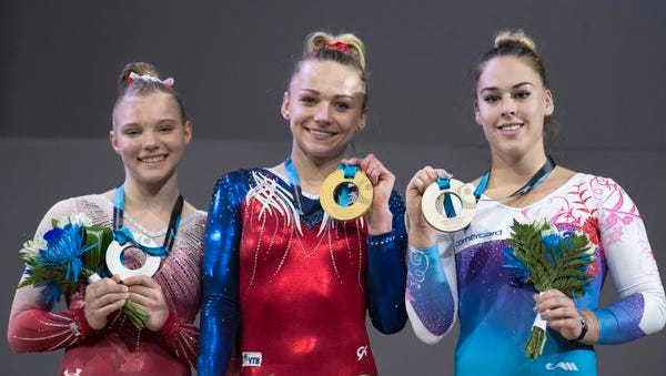 Jade Carey, left, of Phoenix won silver medals on vaulting and floor exercise at the World Artistic Gymnastics Championships in Montreal.