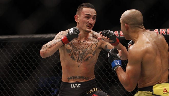 Max Holloway was to defend his featherweight title at UFC 226.