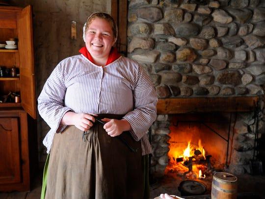 Historical interpreter Emily Havlena portrays a French merchant's wife.