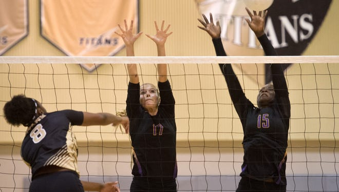 Fort Pierce Central's Aspen Taylor (center) and Brianna Jackson try to defend against a Treasure Coast spike from Wandaleen Harris (left) during the third game of the high school volleyball match Tuesday, Sept. 13, 2016, at Treasure Coast High School in Port St. Lucie. Fort Pierce Central beat Treasure Coast 3-0.   CQ Aspen Taylor, Brianna Jackson, Wandaleen Harris