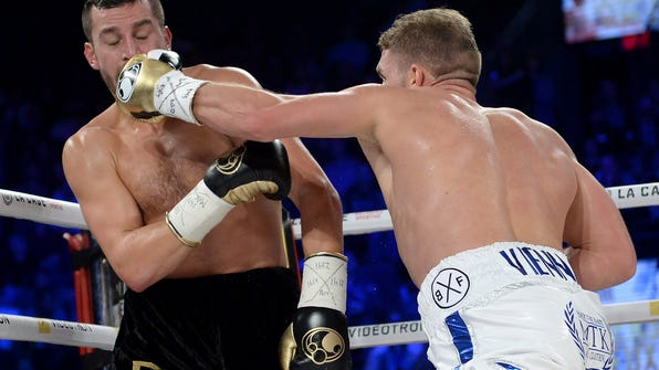 Billy Joe Saunders, right, of Britain, lands a punch on David Lemieux, of Canada, during their WBO middleweight boxing title in Laval, Quebec, Saturday, Dec. 16, 2017. (Ryan Remiorz/The Canadian Press via AP)