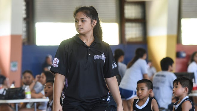 Crusaders Grey coach Eryn Palconit is shown in this file photo during a Guam Youth Basketball Association Drug Free League game at Astumbo Gym on June 30, 2018.