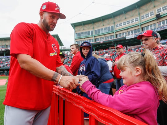 Matt Adams signs an autograph for Sophia Chapman, 7, of Neosho, at Hammons Field before the St. Louis Cardinals vs. Springfield Cardinals game on Friday, March 31, 2017.
