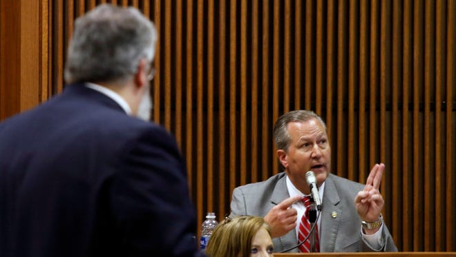 Mike Hubbard answers questions from Deputy Attomey General Matt Hart on Wednesday, June 8, 2016  in Opelika, Ala. Hubbard faces 23 felony ethics charges accusing him of using his political positions to obtain $2.3 million in work and investments for his companies. (Todd J. Van Emst/Opelika-Auburn News via AP, Pool) MANDATORY CREDIT