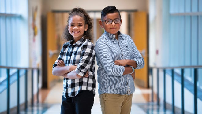 Fifth graders Tiuna Capel and Diego Diaz at East North Street Academy on Wednesday, August 10, 2016.