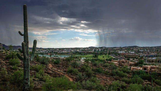 Rain falls south of Fountain Pond Tuesday, Aug. 30, 2016 in Fountain Hills, Ariz.