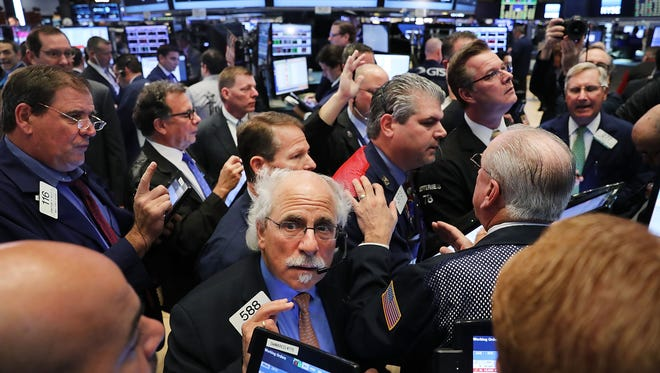 Traders work on the floor of the New York Stock Exchange (NYSE) the morning after Donald Trump won a major upset in the presidential election on Nov. 9 in New York City.