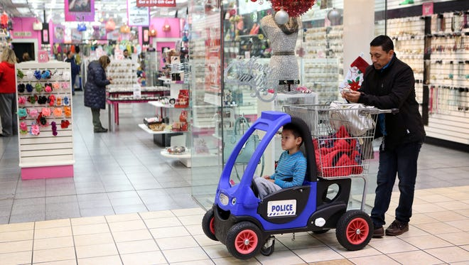 Mall-goers take a break while shopping Dec. 23, 2014, at Jefferson Mall on the south side of Louisville, Ky.