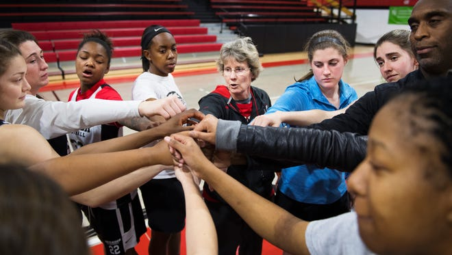 Jayne Arledge, head coach of North Greenville University women's basketball, huddles with her team during practice on Thursday, February 16, 2017.