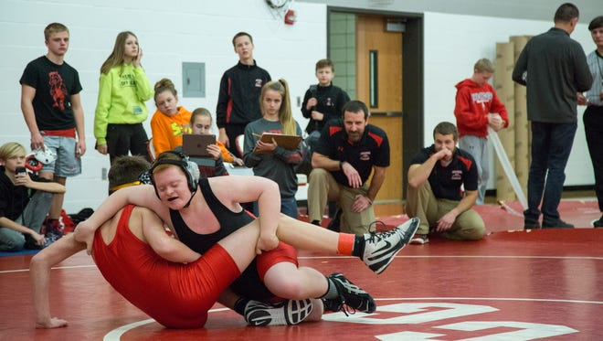 Cael Lockhart, an eighth grader from ADM middle school wrestles Brayden Broderick, from Dallas Center-Grimes during a meet between their schools on Tuesday, Dec. 19, 2017, at  Dallas Center-Grimes High School in Grimes. Lockhart has Down syndrome and has competed with his team throughout the season.