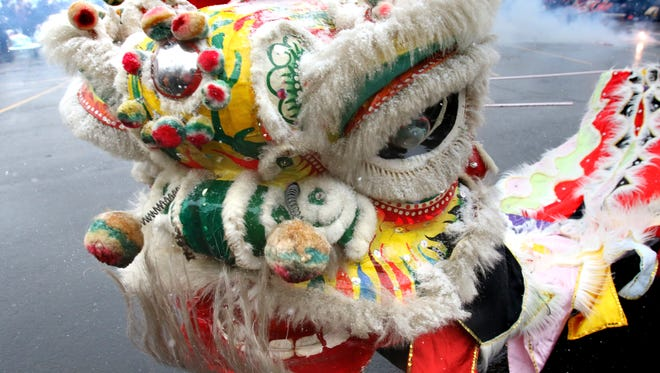 A lion from the ShaoLin Center of Waukesha performs a traditional lion dance at the Golden Gate Restaurant in Waukesha. This year's Chinese New Year celebration at the restaurant is Saturday.