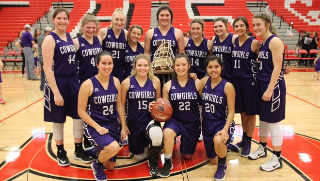 The Mason High School girls basketball team poses with their Region IV-2A championship trophy Saturday in New Braunfels.