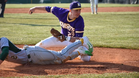 North Henderson's Riley Johnson (23) tries to put the tag on A.C. Reynolds'Andrew McKay.