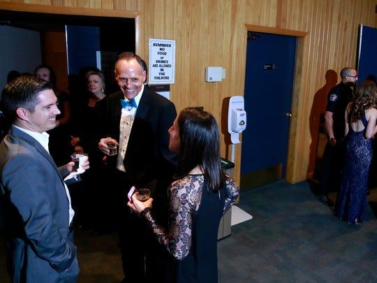 Farmington Mayor Tommy Roberts, center, talks with Jason and Abby Calcote at the San Juan County Mayors' Ball for Charity on Friday at the Farmington Civic Center.