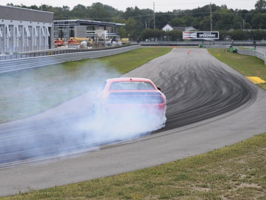 A 2017 Dodge Hellcat burns out on the track.
