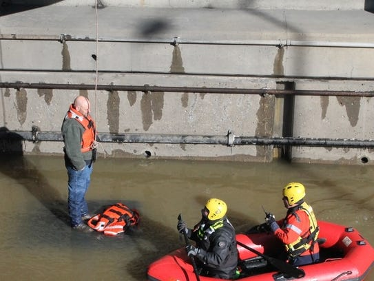 Jason Corbin of Irwin is rescued from flood waters