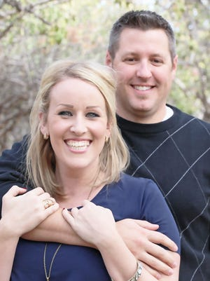 Jo An Clark, 31, of Gilbert, poses with her fiance Mark Warner. Clark twice battled breast cancer, and is now in remission and working out again at a Tempe gym. Most important to her, she says: She can get back up on her surfboard.