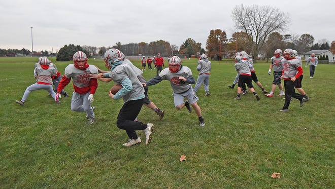The Shelby Whippets go through practice drills in preparation for Friday's 7:30 p.m. Division IV regional championship game against Bellevue at Ashland's Community Stadium.