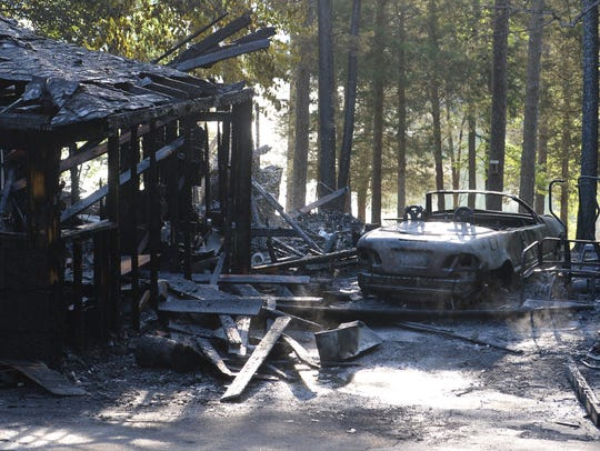 Charred remains of a fire at 180 Rita Lane in Townville