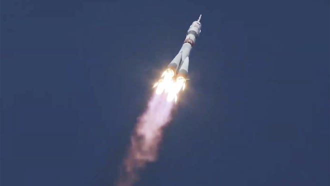 In this grab taken from video footage released by Roscosmos Space Agency, the Soyuz-2.1a rocket booster with Soyuz MS-17 space ship carrying a new crew to the International Space Station (ISS) blasts off at the Russian leased Baikonur cosmodrome, Kazakhstan, Wednesday, Oct. 14, 2020. A trio of space travelers has launched successfully to the International Spce Station, for the first time using a fast-track maneuver to reach the orbiting outpost in just three hours. NASA's Kate Rubins and Sergey Ryzhikov and Sergey Kud-Sverchkov of the Russian space agency Roscosmos lifted off as scheduled at 10:45 a.m. (1:45 a.m. EDT, 5:45 a.m. GMT) Wednesday from the Russia-leased Baikonur space launch facility in Kazakhstan for a six-month stint on the station.