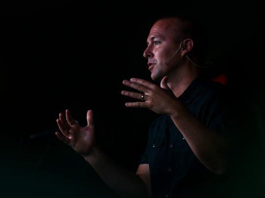 Pastor Jedidiah Coppenger addresses his congregation