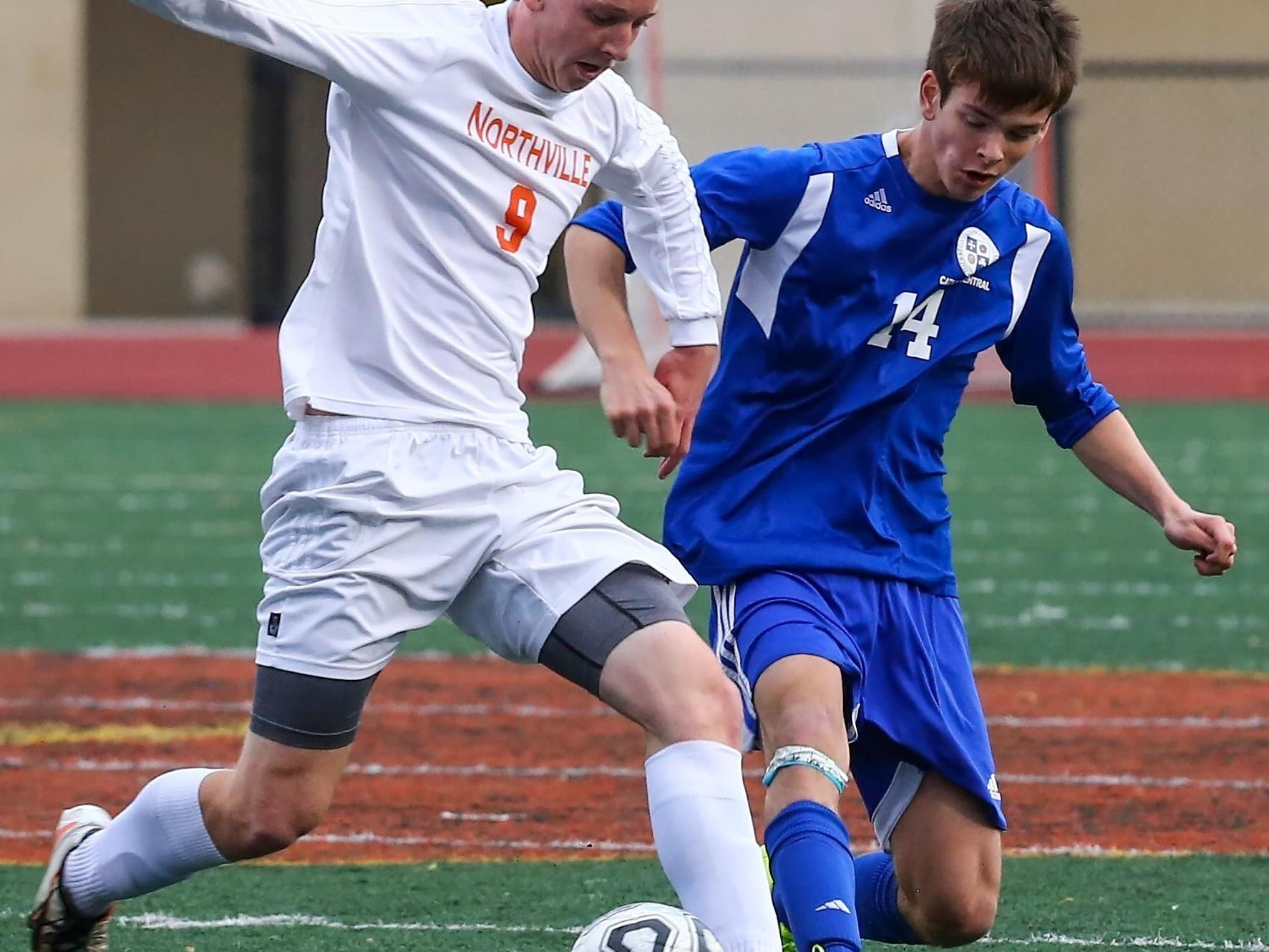 Northville defender Garret Weaver (left), taking on Catholic Central's Noah Walter, was named boys soccer All-Area Player of the Year.