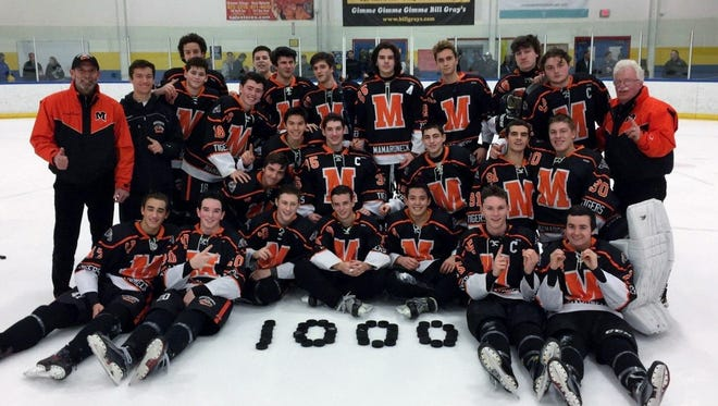 Mike Chiapparelli (far right) got to celebrate his 1,000th varsity win between hockey and baseball after Mamaroneck beat Webster-Schroeder on Friday.