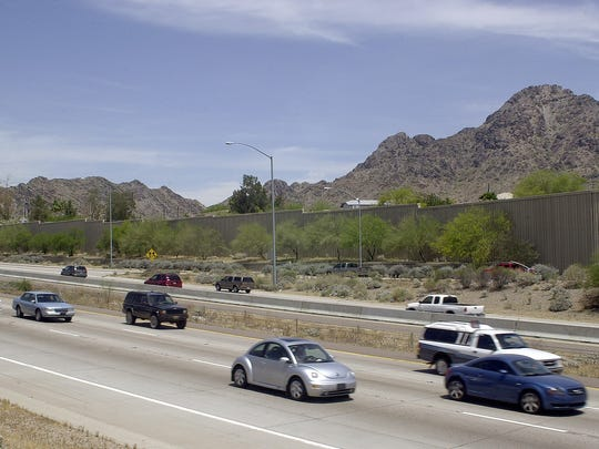 Commuters cruise along State Route 51, currently known