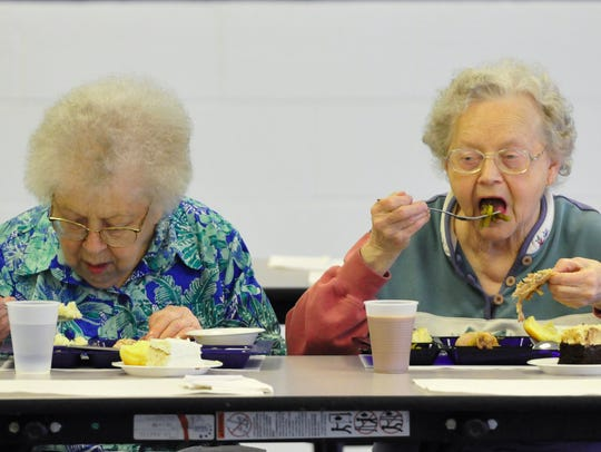Alice Niner, left, and Dorothy Thomas enjoy lunch Monday,