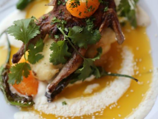 Griddled quail with mandarin orange, tempura cauliflower,