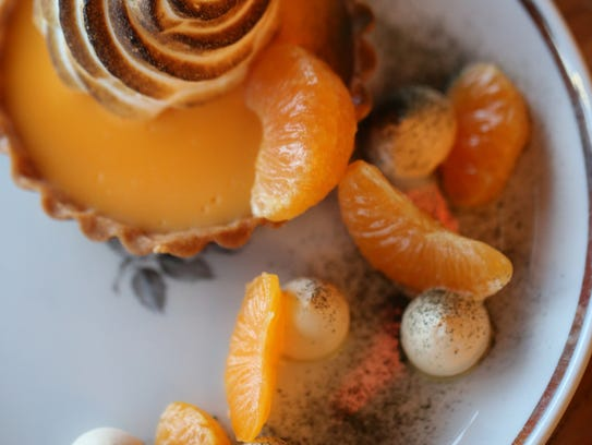 A mandarin tart with shiso powder, fresh clementines,
