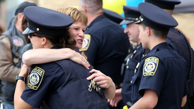 "Gates officer, Becca Leonard, receives a hug from Kate Meddaugh of Gates Saturday at the Gates Walmart. I'm supporting people who support us, it's a little thing we can do to show our support."" Meddaugh said."