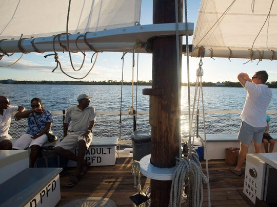 "Three groups, including Delroy Bent (from left) and Val Bent, of West Yorkshire, England, Vincent Peltier, of Port St. Lucie, and the Schell family (right), of St. Louis, sailed on the Schooner Lily on Nov. 7, 2017, on the St. Lucie River in Martin County. ""It was excellent and relaxing,"" Val Bent said."