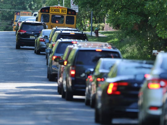 A school bus drives down Washington Ave. in Lakewood,