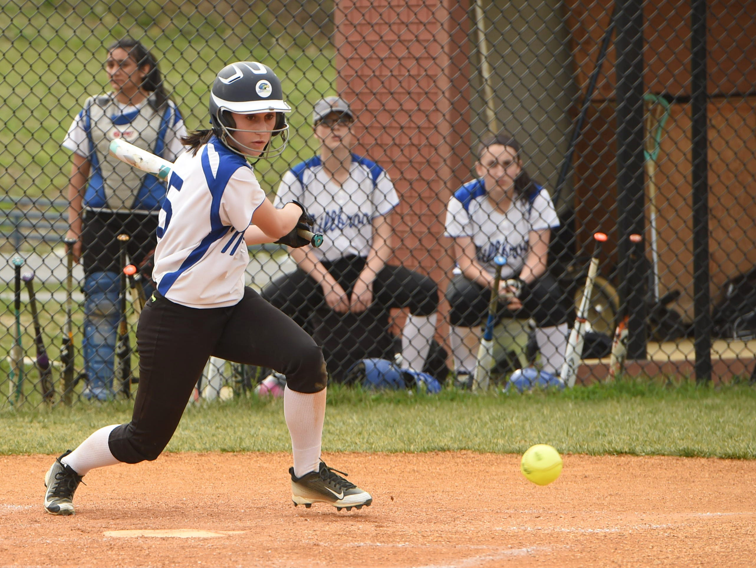 Millbrook's Sierra Guardiola slices the ball down the first base line during Monday's game against Pine Plains.