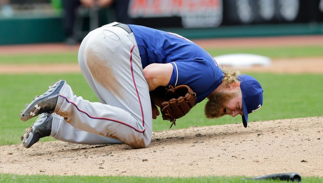Andrew Cashner reacts after getting hit by the broken bat.