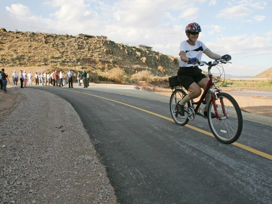 Mary Ghacker rides her bike down the Webb Hill extension of the St. George trial system in this file photo.