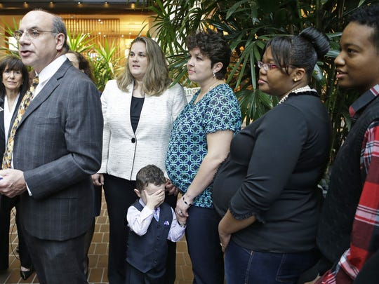 Cincinnati attorney Al Gerhardstein, left, stands in April 2014 with same-sex couples who want Ohio to recognize their marriages. Gerhardstein's firm has asked the U.S. Supreme Court to review a recent federal appeals court ruling that upheld four state bans on same-sex marriages, including Ohio's and Kentucky's.