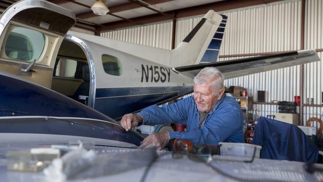 Richard Goldman, President of Glendale Airport Pilot association, works on his Duke airplane at Glendale Municipal Airport on Thursday, Feb. 1, 2018.