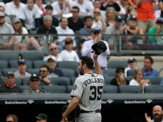 Houston Astros starting pitcher Justin Verlander tips his cap as he leaves a baseball game during the seventh inning against the New York Yankees at Yankee Stadium, Monday, May 28, 2018, in New York. (AP Photo/Seth Wenig)