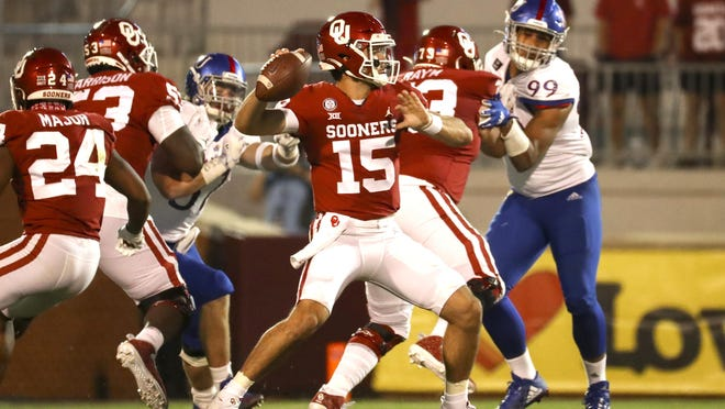 Oklahoma Sooners quarterback Tanner Mordecai (15) throws during the second half against the Kansas Jayhawks on Nov. 7 at Gaylord Family-Oklahoma Memorial Stadium.