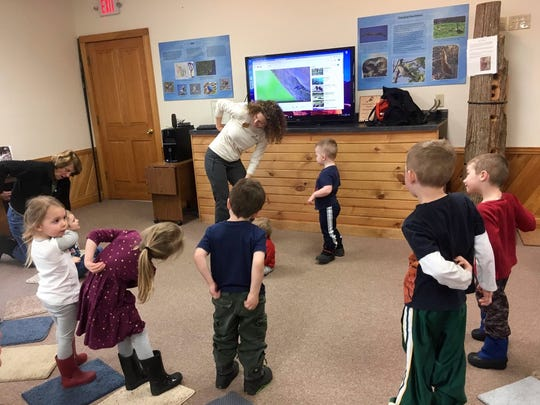 """Kids """"preening"""" their imaginary feathers at Woodland Dunes Nature Center and Preserve in Two Rivers."""