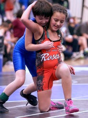 Olivia Gonzales, right, of the Tumwater Mat Rats works
