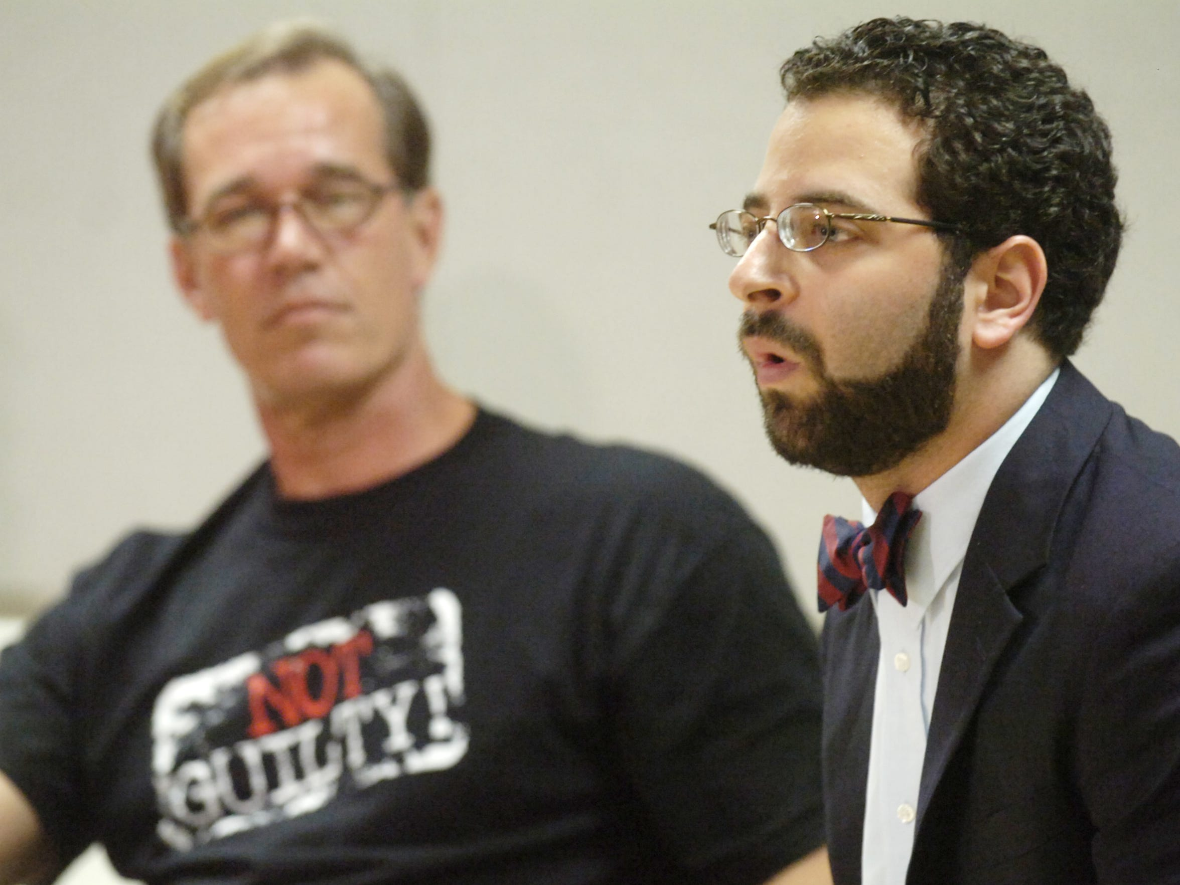 FILE- William Dillon listens as Seth Miller, executive director of the Innocence Project of Florida speaks during a press conference Thursday in Viera, FL Thursday, December 11, 2008.   Dillon was cleared Wednesday of murder charges after spending 27 years in jail.