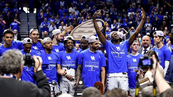 Kentucky players celebrate after their SEC Men's Championship victory over Arkansas at Bridgestone Arena Sunday, March 12, 2017 in Nashville, Tenn.