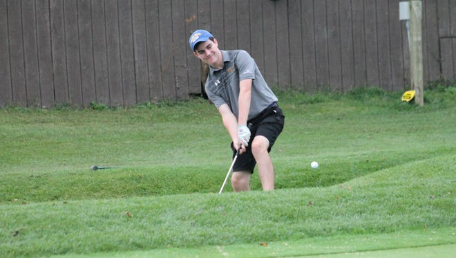Junior Max Lane shows his chipping prowess for Seven Hills.