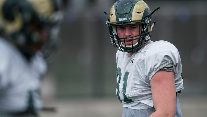 Colorado State University junior defensive lineman Jan-Phillip Bombek (91) participates in drills during a practice on Wednesday, April 4, 2018, at the team's practice field on CSU's campus in Fort Collins, Colo.
