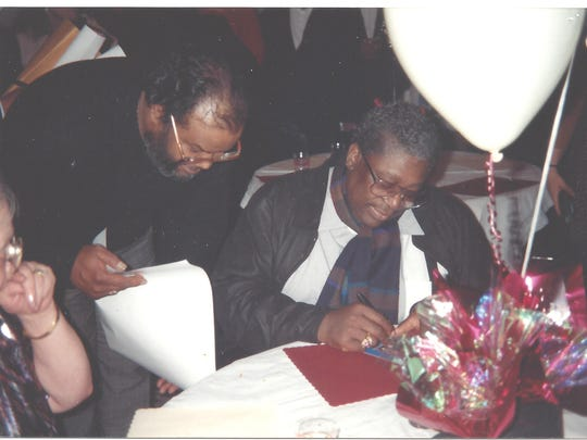 B.B. King, right, signed several items for Cornelius Black at the 1995 concert in Des Moines.