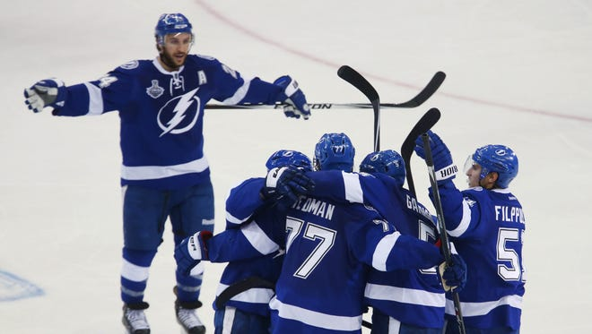 Tampa Bay Lightning defenseman Jason Garrison (5) is congratulated by teammates after scoring a goal against the Chicago Blackhawks in the third period in game two of the 2015 Stanley Cup Final at Amalie Arena.